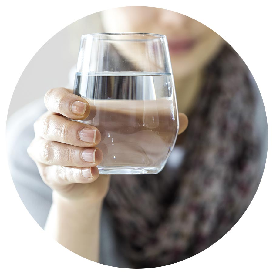 Woman holding a glass of alkaline water